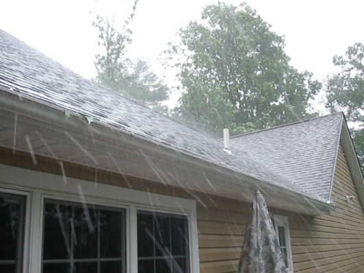 Hail Storm Hitting A Roof Denver Roofing Installation