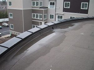 Repairing Ponding Water On The Roof Denver Roofing