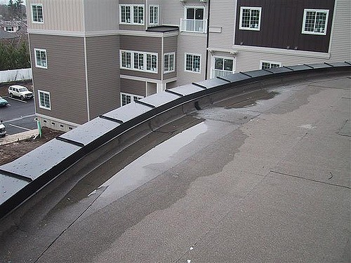 Flat Roof With Water Ponding Denver Roofing Installation