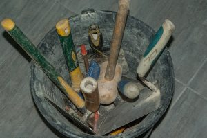 roof repair image showing roofing tools